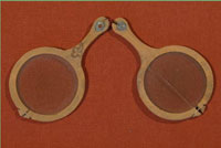 A pair of leather spectacles, found, among other artifacts, in 1953 beneath the floorboards of Kloster Wienhausen, near Celle, in Germany. (View Larger)