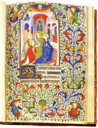 A miniature of the Annunciation from a French Book of Hours showing very elaborate manuscript illumination.