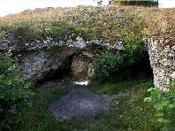 Southern entrance (on left) to the big Vogelherd Cave.  Photo: Jochen Duckeck. (Click on image to view larger.)