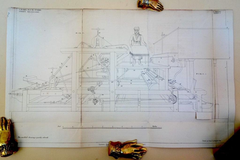 This photograph of the drawing of Cobb's machine for his patent has shows flap down on the right side of the machine.