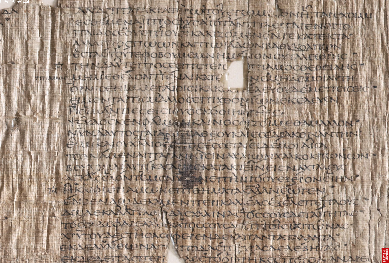 "An enlarged photograph of a section of  the digitized Bankes Homer. P. Lond. Lit. 28, TM 60500. Notes in the left margin of the page include the names of characters to ""passage of direct speech as well as abbreviated notes marking narrative sections in the text."""