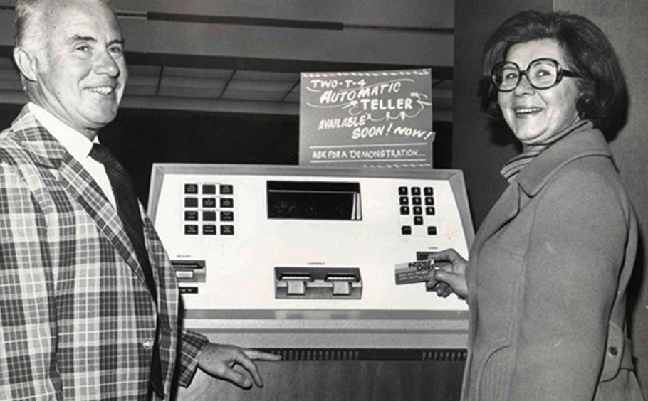 People using an early ATM at Central Northwestern National Bank in 1976.