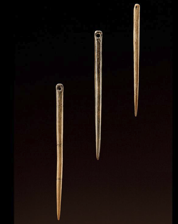 Bone needles from Xiaogushan, Liaoning Province, China, about 30,000–23,000 years old. Photo by Chip Clark, Smithsonian Institution,
