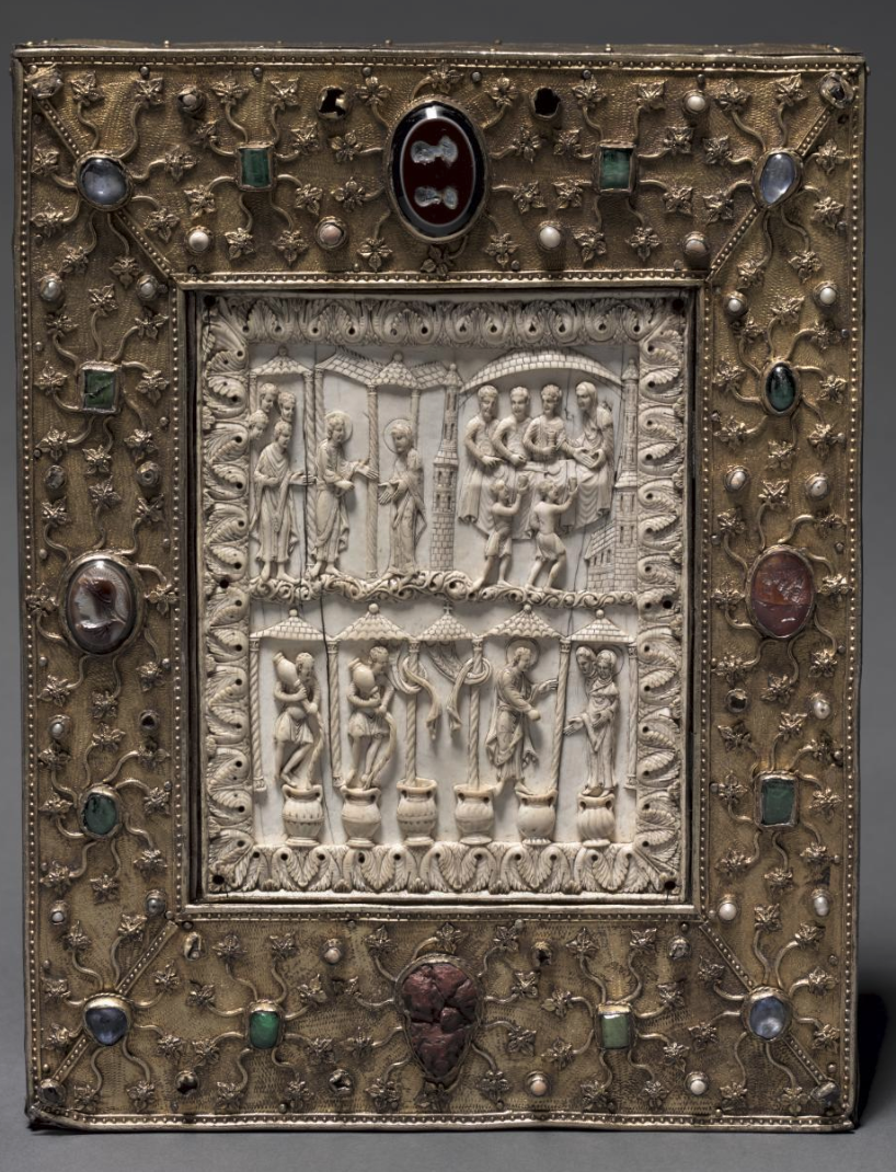 """This sumptuous object closely resembles a deluxe medieval book cover in both form and decoration. It was likely commissioned by Otto the Mild, Duke of Saxony (reigned 1318–48) around 1340. It was made to contain a leaf from each gospel and relics of the 11,000 virgins and 4 other saints. These relics were originally kept in a cavity behind the delicately carved ivory plaque depicting scenes from the Wedding at Cana (John 2:1–11). The story of Christ"