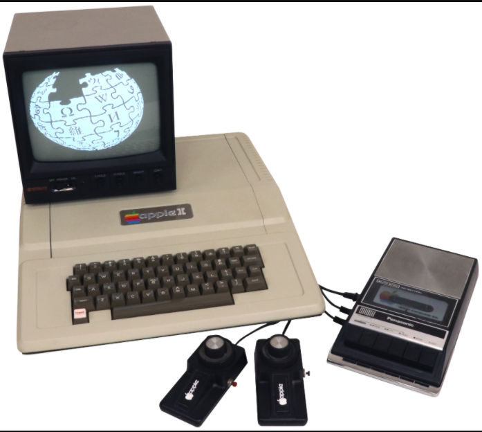 A clever photograph of the standard configuration of the Apple II taken with the Wikipedia in mind since the monitor displays the Wikipedia logo.