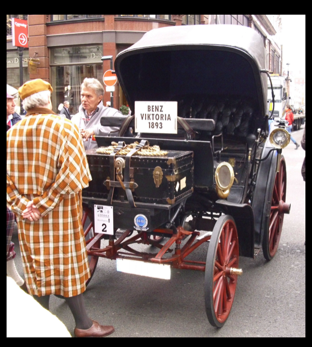 A restored Benz Victoria. The sign indicates that it is a 1893 model.