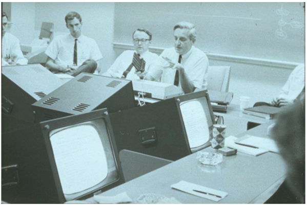 Don Andrews, Bill English, and Doug Engelbart at SRI's Augmentation Research Center during a meeting with sponsors of the program.  Each participant had access to a display and a mouse.