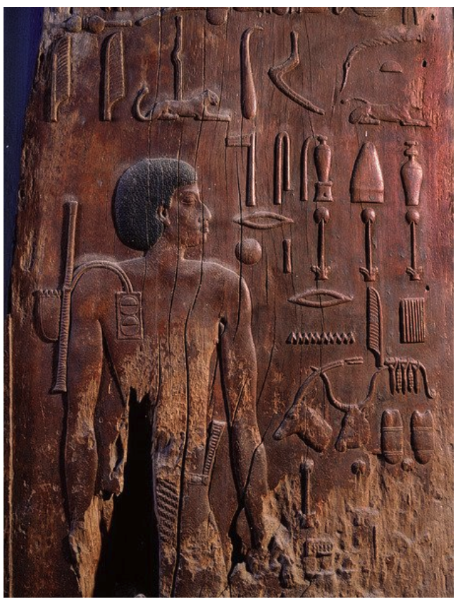 Wooden panel of Hesy-Ra showing all the instruments that he used, including writing instruments.