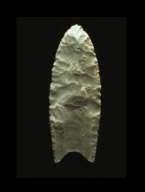 A Clovis projectile point created using bifacial percussion flaking (that is, each face is flaked on both edges alternately with a percussor)