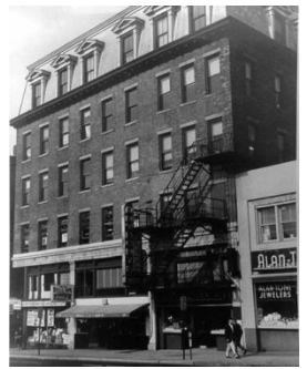 Building in which the New Haven District Telephone office and first telephone exchange were located in New Haven, Connecticut, in the store front with the awning.