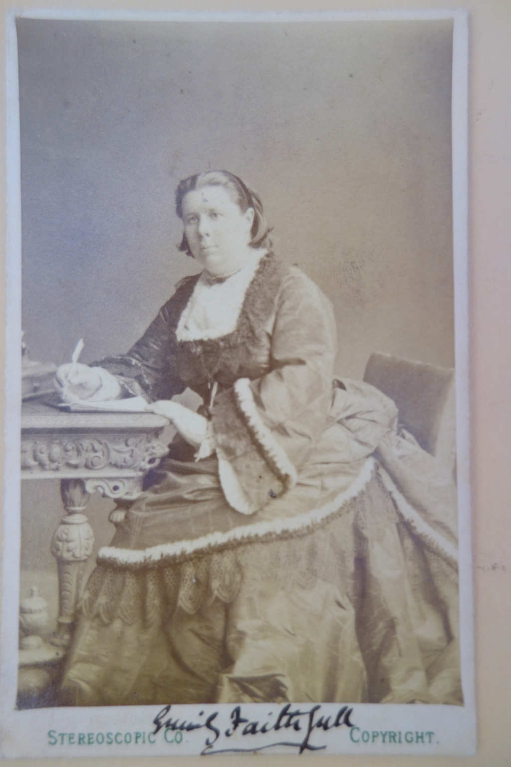 Carte de visit photograph of Faithfull with her autograph in the lower margin.