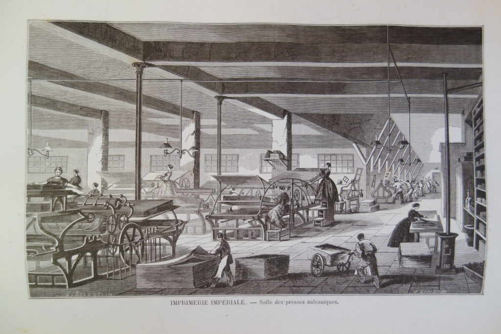 Women are operating the printing machines. In the background men are operating the hand-presses.