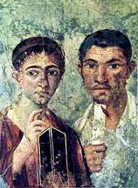 A fresco of a Pompein couple with stylus, wax tablets, and papyrus scroll, preserved in the Museuo Archeologico Nazionale. (View Larger)