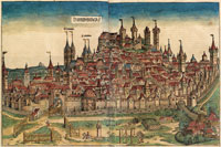 A view of Nuremberg--folio 99v/100r of the Nuremberg Chronicles--showing Stromer's paper mill, bordering the city on the bottom right. (View Larger)