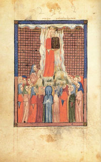 From the Sarajevo Haggadah: Moses upon Sinai, holding the Ten Commandments. (View Larger)