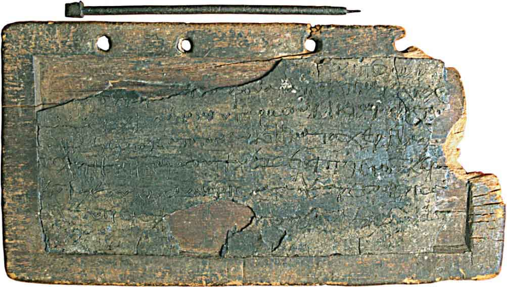 A wooden wax tablet with bronze stylus and eraser, originating from Egpyt circa 600. (View Larger)